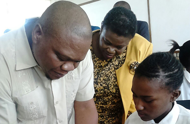 Going hi-tech ... Education MEC Tate Makgoe shows Grade 8 learner Nomakhosazana Qhina of Wongalethu Secondary School in Bethulie how to solve a maths problem while Mohokare Local Municipality executive mayor Agnes Shasa looks on.