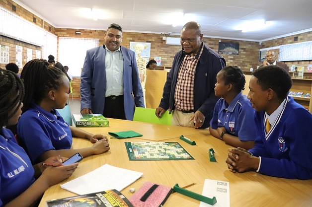 MEC for Education, Dr Tate Makgoe with KST Fezile Dabi District Manager, Nathan Pillay, interacting with Nkgopoleng Secondary School learners in the renovated library.